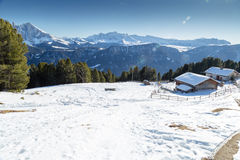 High-altitude mountain hut in front of a panorama of snow-capped Stock Photo