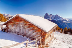 High-altitude mountain hut in front of a panorama of snow-capped Stock Images