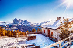 High-altitude mountain hut in front of a panorama of snow-capped Stock Photos