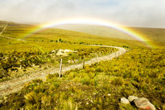 High Altitude Road With Rainbow Royalty Free Stock Photo