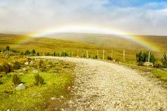 High Altitude Road With Rainbow Stock Photos