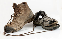 High-altitude and sandal boots. Worn and dirty  high-altitude and sandal trekking boots Stock Image