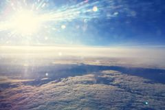 High altitude sky. View of sky from high altitude, sparkling effect of the sun due to window Stock Photography