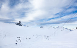 High altitude slopes and ski-lifts in Zermatt ski area stock image