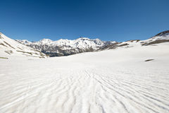 High altitude snow melting pattern Stock Photo