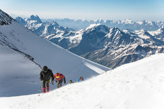High-altitude tourists climb the mountain Stock Photo