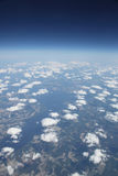 High altitude view of fluffy clouds sky and earth Royalty Free Stock Images