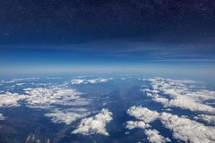 High altitude view between sky and space , in to the dark. Sky view plane Stock Image