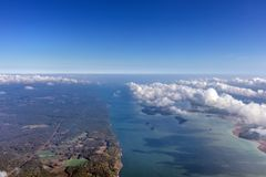 High altitude view between sky and space , in to the dark. Sky view plane Royalty Free Stock Photo