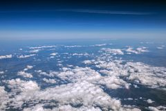 High altitude view between sky and space , in to the dark. Sky view plane Royalty Free Stock Photos