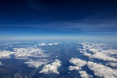 High altitude view between sky and space , in to the dark. Sky view plane Stock Photos