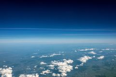 High altitude view between sky and space , in to the dark. Sky view plane Royalty Free Stock Images