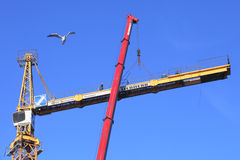 High-altitude work, installation of construction tower crane usi Stock Image