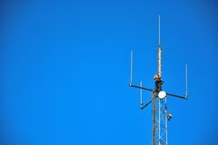 High altitude worker working on a cellphone mast Stock Image