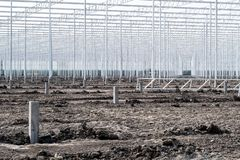 High aluminium piles are erected to build a greenhouse royalty free stock photo