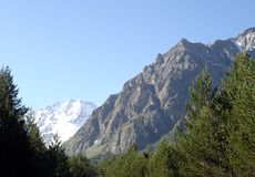 Mountains of the Caucasus. High ancient mountains of the Caucasus majestically rise against the background of the sky in Russia Stock Photography