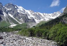 Mountains of the Caucasus. High ancient mountains of the Caucasus majestically rise against the background of the sky in Russia Stock Photo
