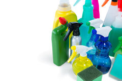 High angel view of colorful spray bottles with sponges and gloves. High angle view of colorful spray bottles with sponges and gloves against white background stock images