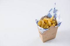High angel view of French fries in carton box. On table royalty free stock photos