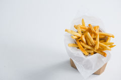 High angel view of French fries in paper bag. On table royalty free stock photos