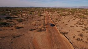 High Angle View Following Pickup Truck on a Typical Arizona Desert Road. 7880 A high angle aerial view of a pickup truck traveling away on a typical Arizona stock video