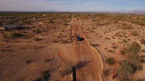 High Angle Aerial View of Pickup Truck on a Typical Arizona Desert Road. A high angle aerial view of a pickup truck traveling on a typical Arizona desert road stock video