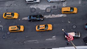 High Angle Aerial View of Traffic Along 5th Avenue in Manhattan. New York City - circa October, 2017 - A high angle aerial view of traffic on 5th Avenue in stock video