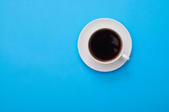 High angle of an aroma cup of coffee over blue flatlay with a co Royalty Free Stock Photography