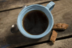 High Angle of Blue Cup Containing Warm Coffee or Tea Royalty Free Stock Photography