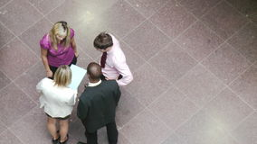 High angle of business people shaking hands in building Royalty Free Stock Photography