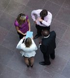 High angle of business people talking in office Stock Photo