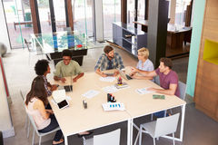 High Angle Of Businesspeople Having Meeting In Modern Office Stock Photo