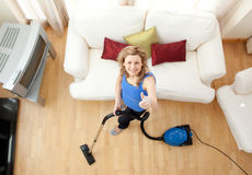 High angle of a cheerful woman vacuuming Stock Photography