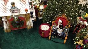High angle of children have their picture taken with Santa Claus. stock video