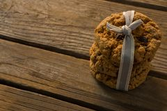Close up of cookies tied with ribbon on wooden table. High angle close up of cookies tied with ribbon on wooden table Royalty Free Stock Photo