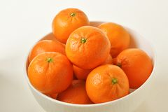 High angle, close up on white bowl full of mandarin oranges royalty free stock image