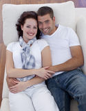 High angle of couple lying on sofa Royalty Free Stock Photography