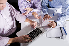 High angle cropped view, office workers on laptop stock images