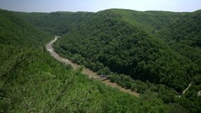 High Angle Establishing Shot of New River Gorge. 8545 A high angle summer establishing shot of the New River Gorge in West Virginia stock footage