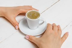 High angle of female hands hold a cup of strong coffee stock photography
