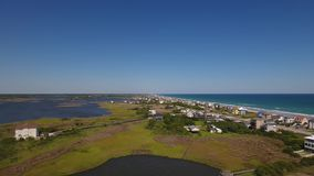 High Angle Aerial Establishing Shot Topsail Island Shoreline. 8540 A high angle forward daytime establishing shot of the homes along the shoreline on Topsail stock video