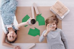Kids during environmental protection classes. High angle of kids lying on paper during environmental protection classes at school royalty free stock photos