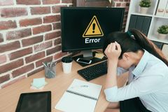 High angle photo of computer getting mistake. High angle photo of office computer getting mistake problem showing error symbol let manager can`t work and sitting royalty free stock image