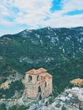 High Angle Photography of Brown Structure Surrounded by Mountains royalty free stock photo