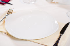 High Angle of Place Setting with White Plate. And Cutlery Stock Image