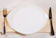 High Angle of Place Setting with White Plate. And Cutlery Royalty Free Stock Image