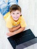High angle portrait of boy with laptop Stock Photos