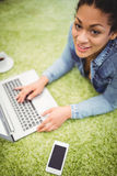 High angle portrait of businesswoman using laptop on carpet Royalty Free Stock Photos