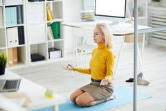 Yoga at Work royalty free stock photo