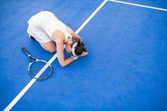 Exhausted Female Tennis Player royalty free stock photo